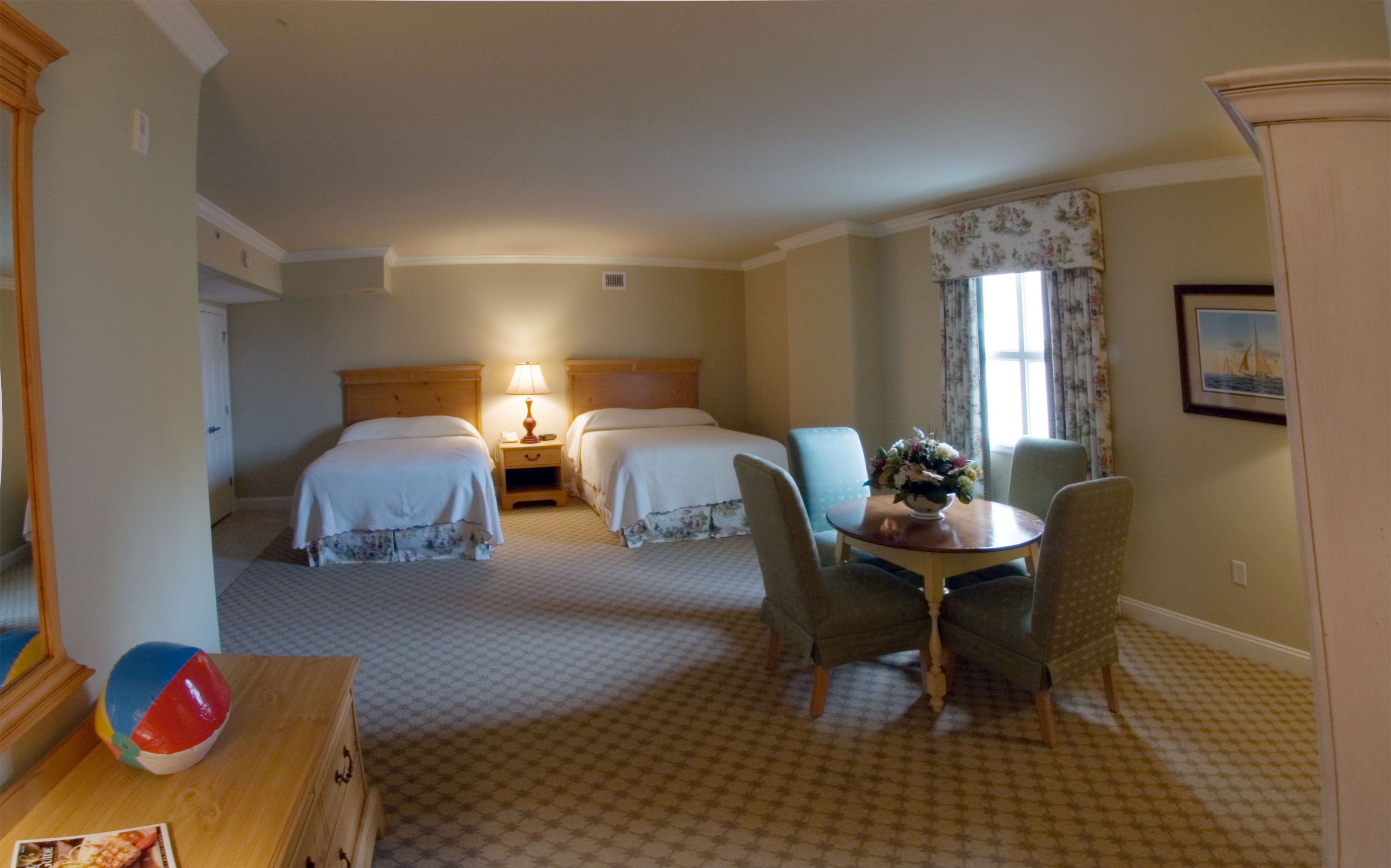 hotel oceanfront room with double beds and lounge in ocean city md